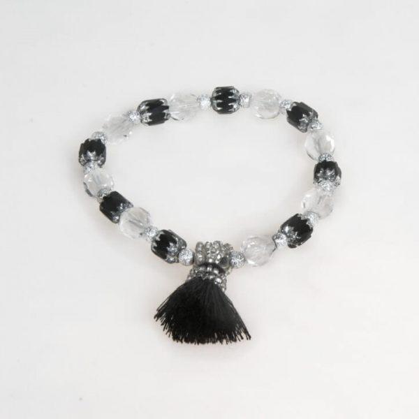 Bracciale elastico con cristalli sfaccettati e perle con nappina